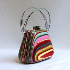 I love this little clamshell purse, from Brazil, made from poured resin. Very cool!