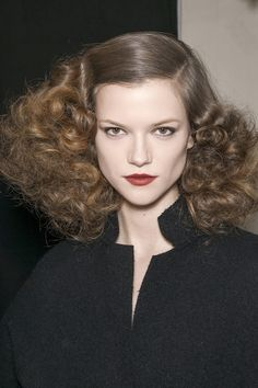Bottega Veneta's Old Hollywood Glamour Ringlets A smooth crown adds a softer element to brushed out curls. As seen at Bottega Veneta, these softer curls are the epitome of romance.
