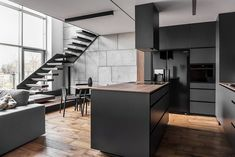 Instantly Captivating Wood and Graphite Apartment in Poznan / Metaforma