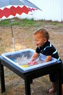 DIY sand and water table.  Perhaps modify to use two bins one sand one water and change them out depending on which one he wants to play with