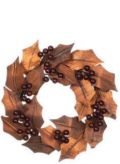 A classic, dressed beautifully in bronze, this magnolia leaf wreath sprinkled with berries, is a symbol of elegance. [Sullivangift.com]