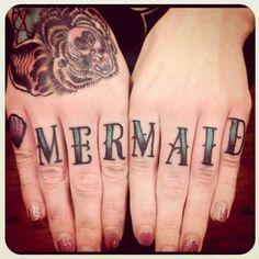 mermaid finger tattoo