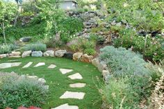 Stone garden path and landscaped slope. Clayson traditional landscape