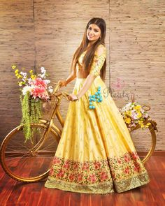 Pragya Nagra looking all pretty in Pleatz new collection sakura. Get your bridal-wear customised from Pleatz. Beautiful yellow color lehenga and blouse with floral design heavy hand embroidery thread work. Skirt with powder blue color pot tassels. Indian Dresses, Indian Outfits, Indian Clothes, Farewell Dresses, Couple Wedding Dress, Powder Blue Color, Yellow Lehenga, Bridal Lehenga Collection, Lehenga Designs