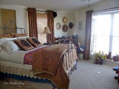 Mobile Home Makeover: sometimes minimal is better.  Angling the wrought iron bed really makes it the focus of this room.