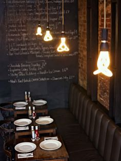 love industrial restaurant interiors. // The new Plumen bulb is very modern yet industrial