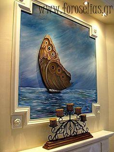 Ζωγραφίσαμε την γύψινη εσοχή στο τζάκι και τοποθετήσαμε μέσα σε αυτήν ένα κομμάτι ξύλο φιλοτεχνημένο με ζωγραφική στο χέρι σε σχήμα ιστιοφόρου που θύμιζε πεταλούδα-