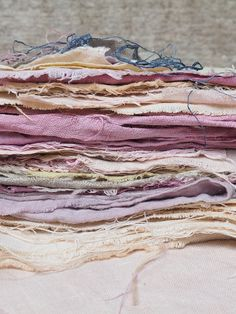 Naturally dyed fabrics - sorbet colours from Summer's garden. How to dye fabric using plants, flowers, leaves and natural processes. beautiful stack of linen