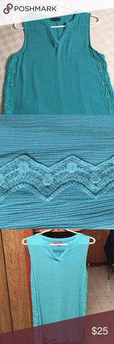 Teal (Tiffany like shade 😉) tunic top Beautiful teal light top, embroidery insets on both sides. Comfortable, only worn a few times. Arm holes are a nice size so you don't feel like you have to layer! Market & Spruce Tops Tunics