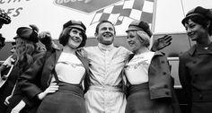 Bruce McLaren poses with his sponsor Dunlop's advertising ladies, 24h Le Mans 1967, France, Le Mans, 10 June 1967. (Photo by…