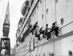 Workers cleaning the Empress of Australia liner at Southampton dock following the ship's return from a Mediterranean cruise inMay 1932