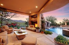 Traditional Landscape/Yard with Trellis, Custom Swimming Pool Waterfall, Cave & Grotto, outdoor pizza oven, Fence