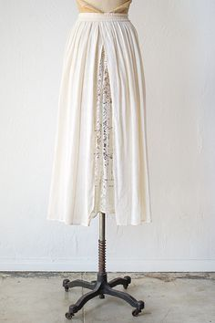 vintage 1970s muslin skirt with lace panel (interesting idea).
