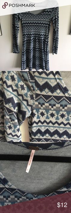 Blue Patterned Dress Long-sleeve blue dress with a tribal-like pattern. Size small. Super comfortable. Only worn a few times. 60% Cotton, 35% Rayon, 5% Spandex. Poof! Dresses Long Sleeve