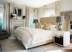 Elegant bedroom design with camel tufted microfiber bed, giraffe pillows, ...