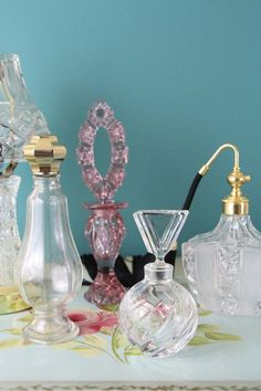 Tall Clear Glass Perfume Bottle with Gold Toned Screw Top Vintage 1969