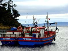 Fishing boats at a small cove next to Port Famine, Punta Arenas, Chile.