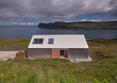 Set on the Isle of Skye, Scotland, this small holiday home has been completed the architecture firm Rural Design. The house, dubbed the Tinhouse thanks to Green Architecture, Residential Architecture, Tin House, Rural House, Rural Retreats, Modern House Design, Modern Houses, Contemporary Design, Barbour