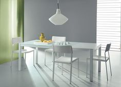 SUNRISE. Sunrise is the proper solution for living-dining area. It is a young and eclectic table for a bright space. Extending dining table, metal structure, glass top, lacquered extension, telescopic. http://www.easy-line.it