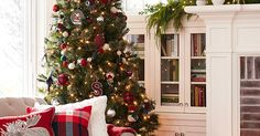 Liked on Pinterest: Step up your Christmas decor game by mixing in a few charmingly classic elements. Soft textures like throw pillows and faux-fur throws keep the living room cozy while pops of blue in the plaid pillow and ornaments on the tree are an unexpected touch that keeps traditional feeling fresh and new. Dont forget to mix fresh and faux greenery for a fragrant (and lasting) festive feel.