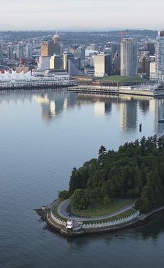 Aerial shot of Vancouver's Stanley Park and Coal Harbour. Photo by Albert Normandin
