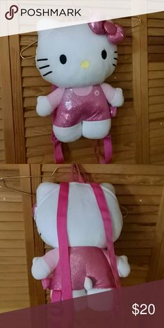 Hello Kitty Plush Backpack Hello Kitty Plush Backpack. Gently used. Clean, no stains or rips. Small zippered opening. Sanrio Bags Backpacks