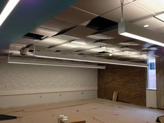 Metal ceiling panels in a classroom and workstations on the 2nd floor of the Arts & Sciences Building are in the process of being installed.