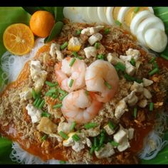Pancit palabok - Filipino rice noodles with shrimp sauce and various toppings
