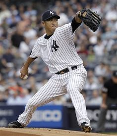 GAME 67: Tuesday, June 19, 2012 - New York Yankees starting pitcher Hiroki Kuroda winds up during the first inning against the Atlanta Braves in a baseball game at Yankee Stadium in New York. (AP Photo/Kathy Willens)