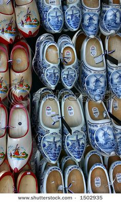 Dutch wooden shoes!! I have a pair and they are the blue and white with windmills!! Love them and they fit my feet and are actually comfortable! Just too noisy for wood floors!!