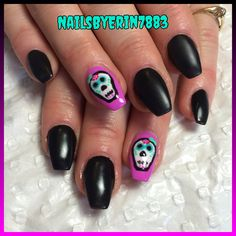 Acrylic coffin shaped nails with skull candy nail art and matte black gel polish