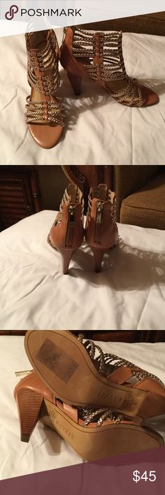 Ivanka Trump size 7 women's Rannon dress sandal Back-zipper closure. Woven strap design throughout. Synthetic lining. Lightly padded footbed. Man-made outsole. Great pre-owned condition.  Size 7. Ivanka Trump Shoes Heels