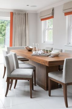AN OPEN DINING ROOM WITH WARMTH, TEXTURE, AND A POP OF COLOR WITH COLORBLOCK DRAPES