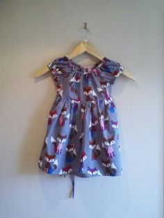 I love this fabric children's fun print ,made up in a simple peasant dress.