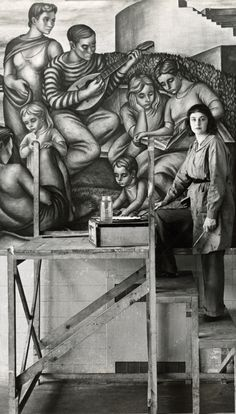 American artist Marion Greenwood (1909-1970) standing in front of mural she painted for the WPA (1940). via wikipedia