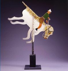 MAN ON A BUCKING HORSE/ Matteo Radoslovich, c. 1947–1972, paint on metal and wood with glass bottle, 40 1/2 x 27 1/2 x 9 3/4 in., American Folk Art Museum, gift of Dorothea and Leo Rabkin, 1983.17.20.