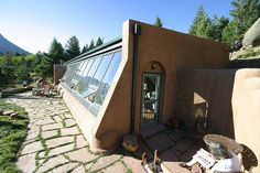 A fantastic example of both eartship and earth-sheltered home construction, this author-built earthship home in colorado was the starting point for an Small Solar Panels, Solar Panel Cost, Natural Building, Green Building, Earthship Home, Earthship Plans, Earthship Design, Earth Sheltered Homes, Earth Bag Homes