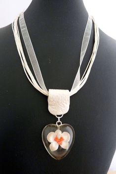 """New """"Captured moments"""" handmade orchid necklace (no mould) #jewelry #jewellery #polymer #polymerclay #handmade #handmadejewelry #orchid #resinjewelry #necklace #uniquejewelry #polymerclayart"""