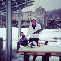 Students take advantage of new solar charging stations during a snow day #winter