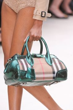 Burberry Prorsum Spring 2013 - Because I always carry a fabulous purse while walking around in my undies.....and a leather jacket???? Who does that?
