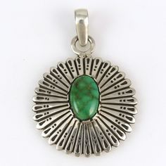 "Sterling Silver Pendant with Stamped Designs and set with Natural Carico Lake Turquoise. 1.25"" Width, 1.875"" Height"