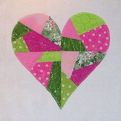 Paper Pieced Heart. Instead of reverse applique, I just used a little bit of hem tape to secure the heart and then sewed around the outside.