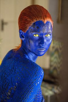 Aries: Female Action Hero - Channel Jennifer Lawrence's X-Men alter ego Mystique with blue body paint and vermillion hair.