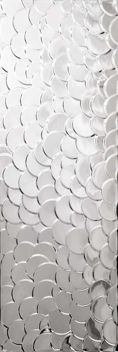 Not for the foor but interesting .... Love this tile? Find it at sammysdesignerflooring.ca/tile Aparici Nordic Silver Shell
