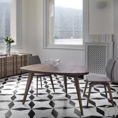Kesino Triangular #DiningTable by #Porada starting from £2,078. Showroom open 7 days a week. #fcilondon #furniture_showroom_london #furniture_stores_london #porada_furniture #porada_tables #modern_tables  #porada_dining_tables