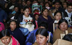 Tradition: Thousands of people attend the celebrations of the Day of the Skull in La Paz, Bolivia. They are greeted by the priest inside the General Cemetery chapel in the tradition which marks the end of the Catholic All Saints holiday