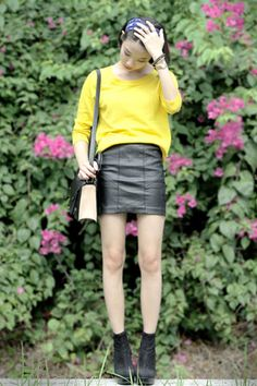 Delvanni Q. of Indonesia // leather skirt paired with boots and sweatshirt // add tights