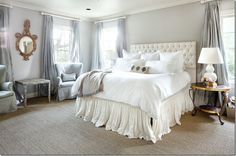 Ruffled Bed Skirt and Drapes.  Mirror over bench....