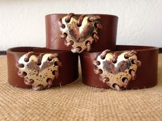 Repurposed leather and thread tied hearts