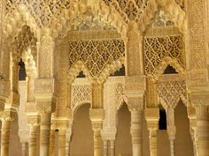 Alhambra Palace tracery, arches, arabic script and geometric patterns
